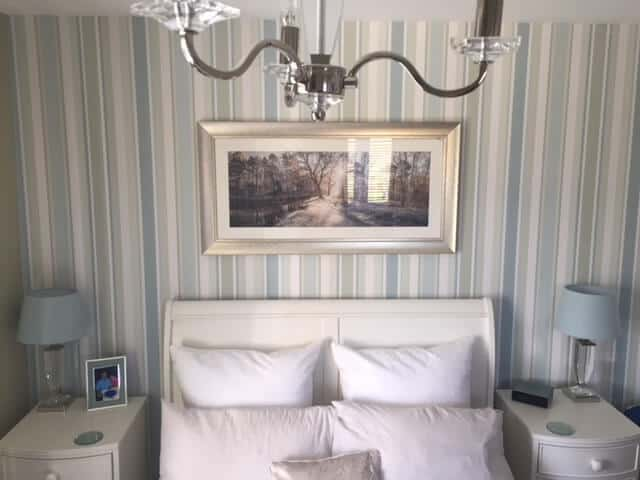 Master Bedroom after Juby Interior Design. Changing to wallpaper with coordinating paint,picture lights and bedding.